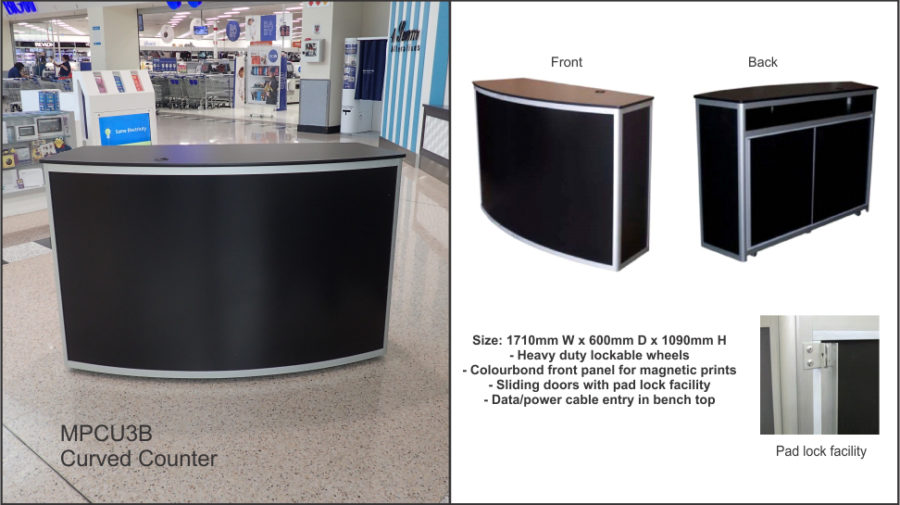 MPCU3B Curved front counter unit (large) in black with • clear anodised frame. Colorbond front panel for client graphics. Parcel shelf to rear. Cable port. Lockable castor wheels to base. Sliding doors to rear with padlock facility.